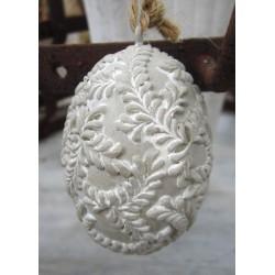 Vackert grått ägg med bladmönster
